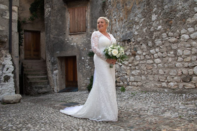 Elegant bride in the Castle of Malcesine on Lake Garda
