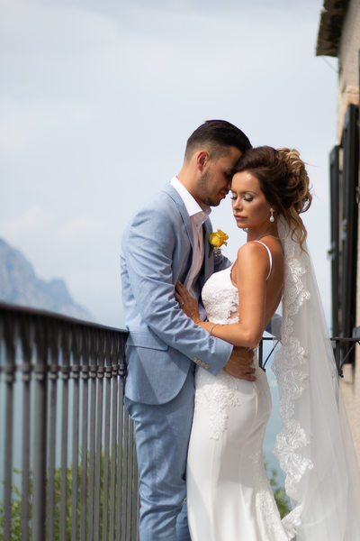Beautiful couple on the balcony of Malcesine Castle