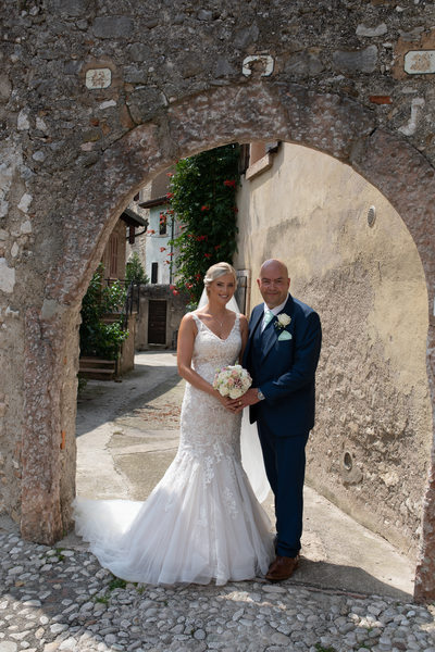 Beautiful bride and proud dad going to Malcesine Castle
