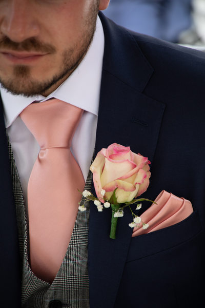 Groom and the button hole
