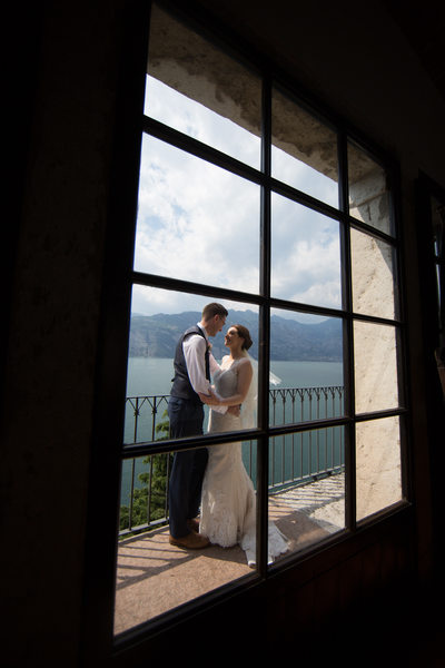 Emma and Chris through the window in Malcesine