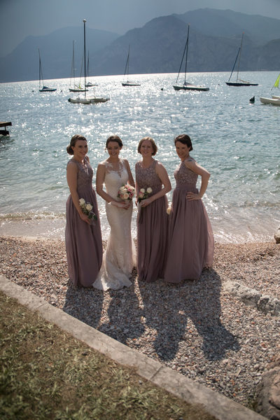 Emma and her maids by the water before the storm