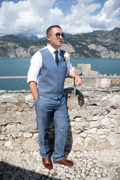 The groom chilling out after the ceremony on Lake Garda