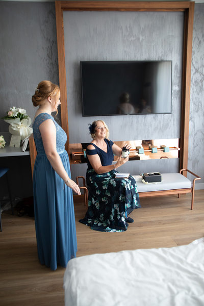 Bride's mum and bridesmaid are getting ready