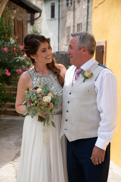 Gemma the bride with her dad before Malcesine Wedding.