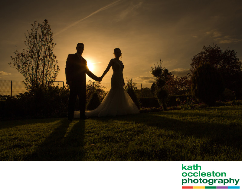 Couple silhouetted against the setting sun