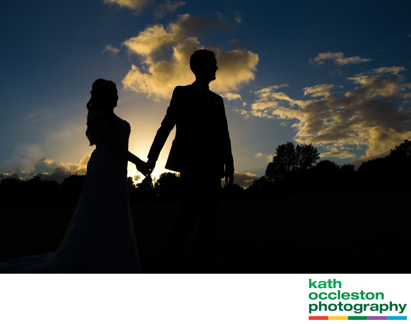 Silhouette of bride and groom In the sunset