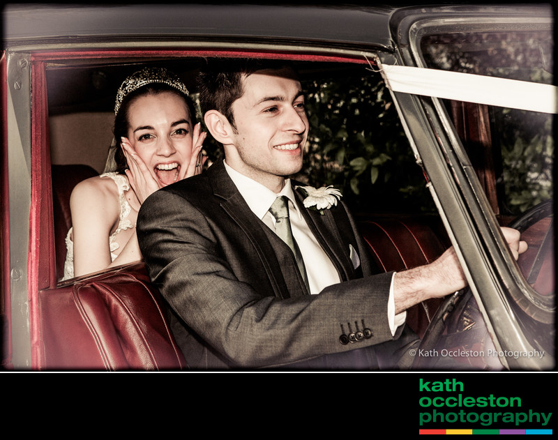 Fun wedding photography in the wedding car