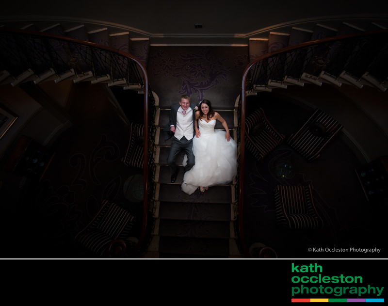 creative wedding portrait on staircase