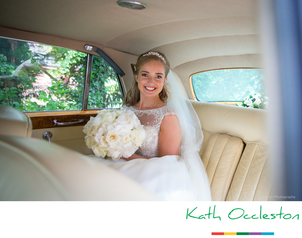 Bride in the wedding Rolls