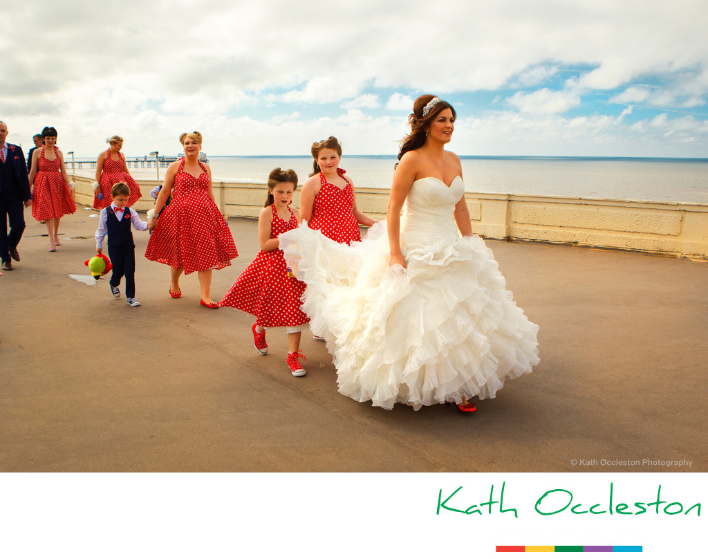 The bridal party walking along Blackpool Promenade