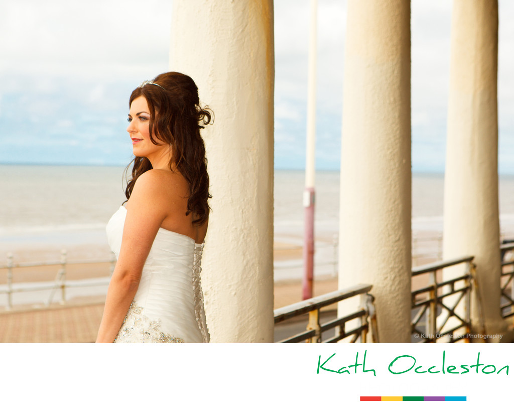 Bride looking out to sea on Blackpool promenade