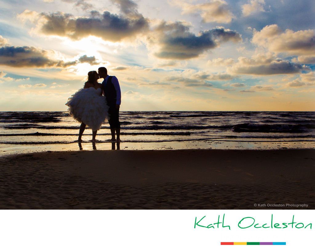 Silhouette of bride and groom on the beach