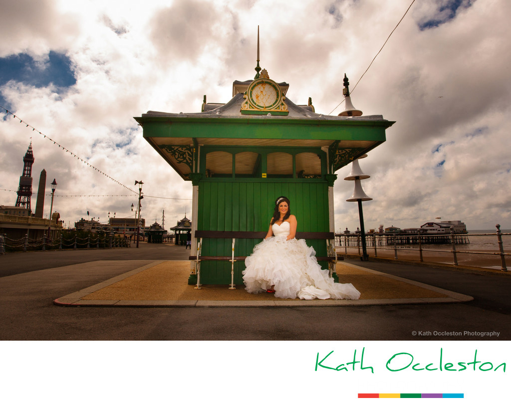 Bride in green shelter on Blackpool Promenade