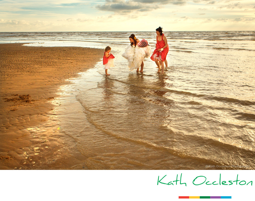 Bride & bridesmaids in the sea at Blackpool