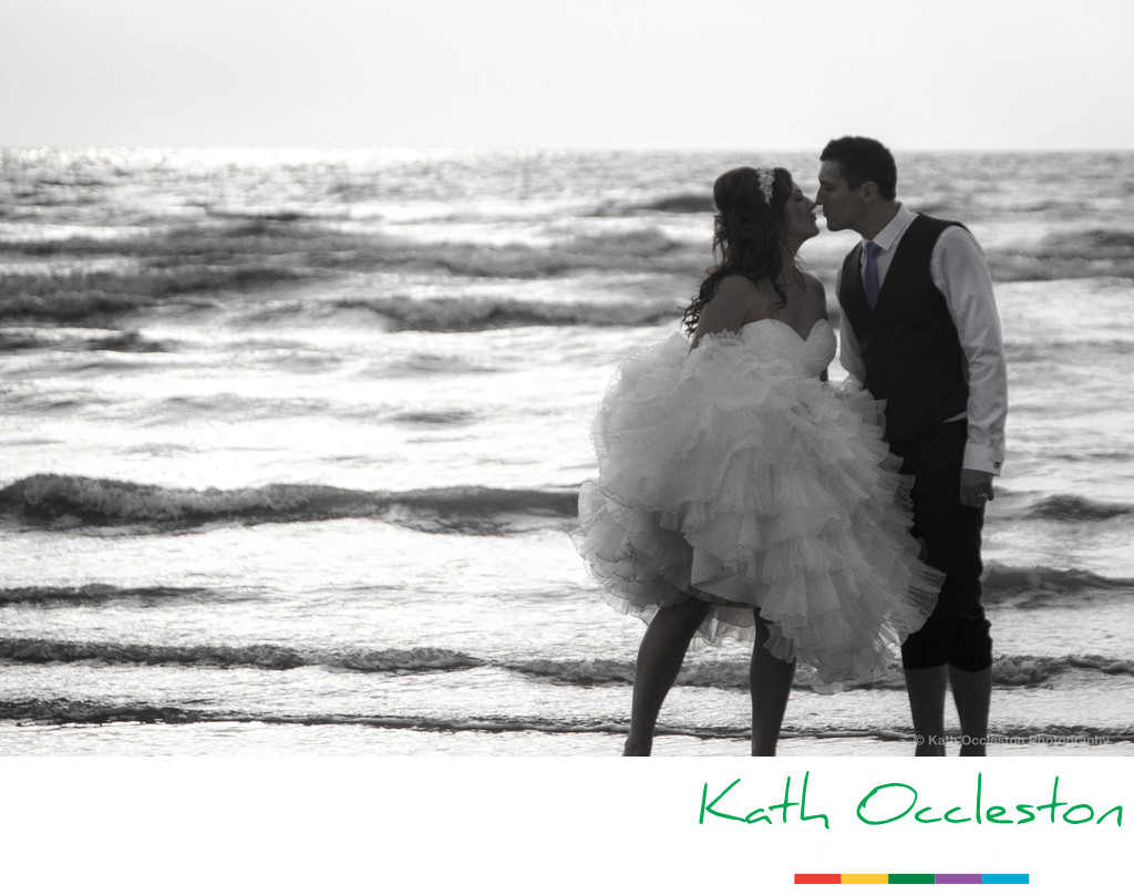 Bride & Groom at the edge of the sea