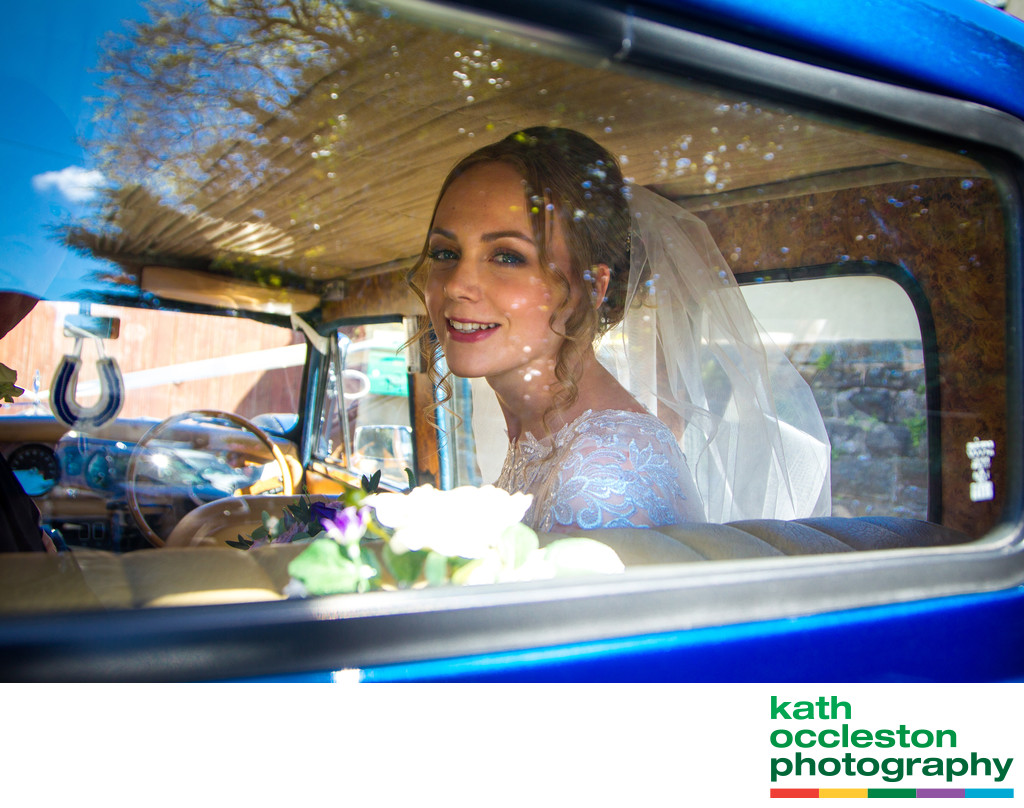 Candid portrait of the bride in the wedding car