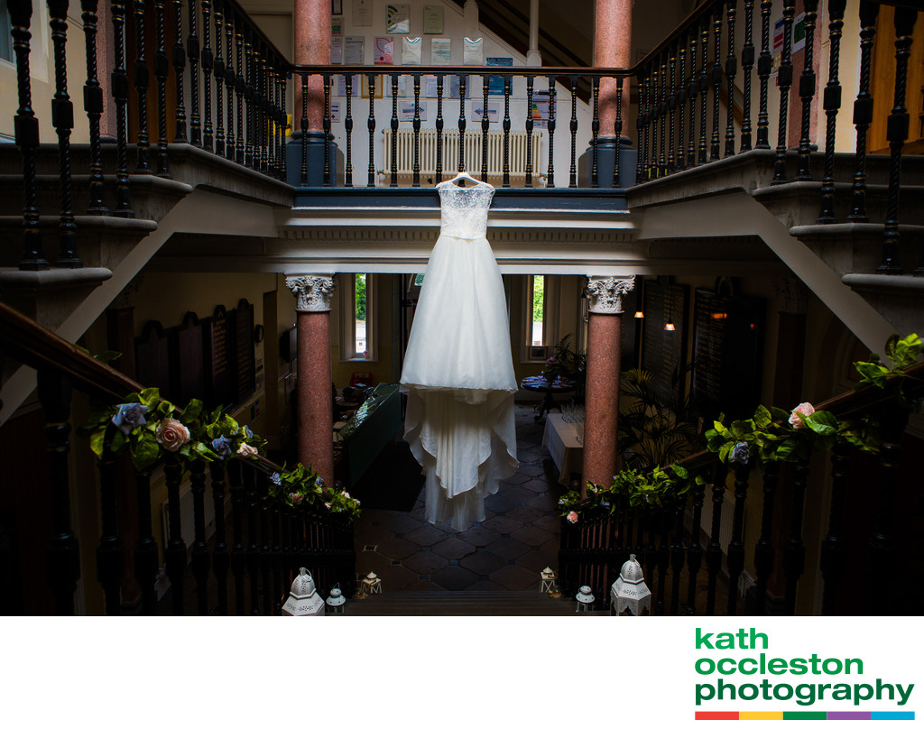 The Wedding Dress hanging up on the stairs