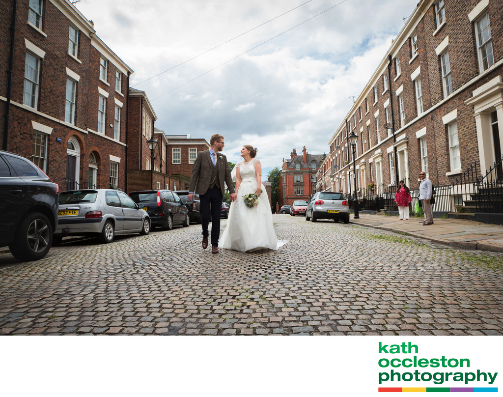 Bride & Groom walking down the street in Liverpool