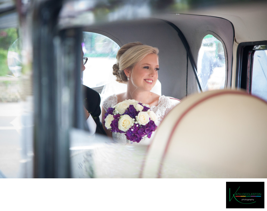 Bride in the wedding car outside St Annes Parish Church