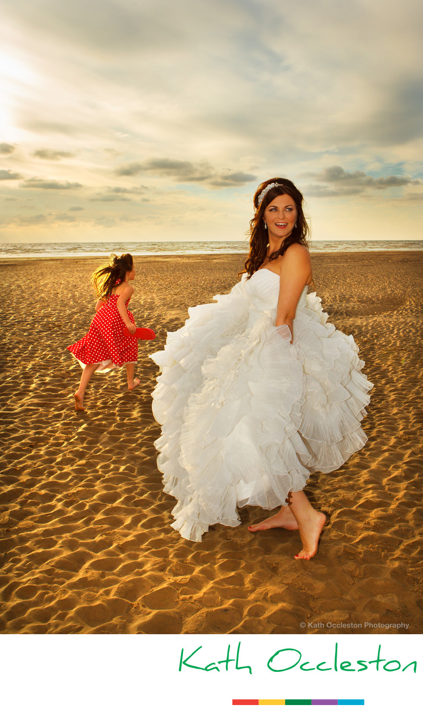Bride and flowergirl on the beach