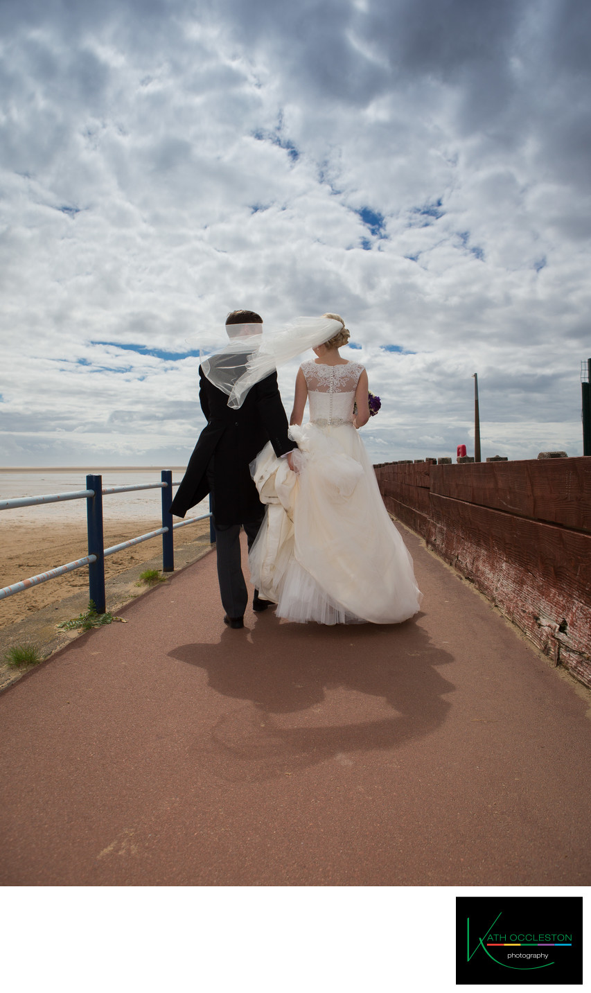 Windy wedding day photography in St Annes on Sea