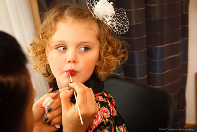 Flowergirl having lipstick put on