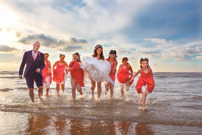 Bridal party having fun in the sea at Blackpool.
