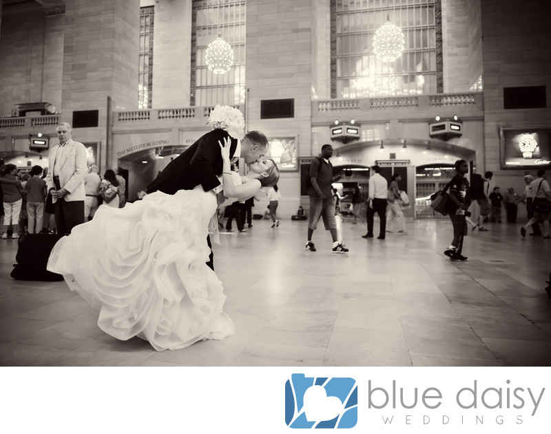Wedding couple dip and kiss in Grand Central Terminal