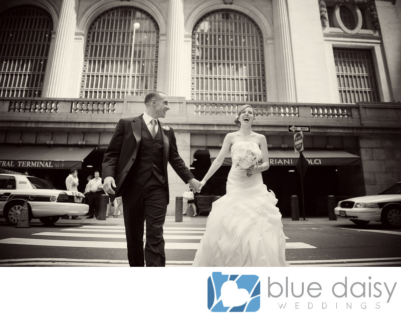 Bride groom walking laughing in front of Grand Central
