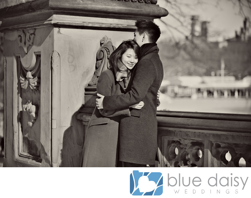 Newly engaged couple sharing a hug at Bethesda Terrace
