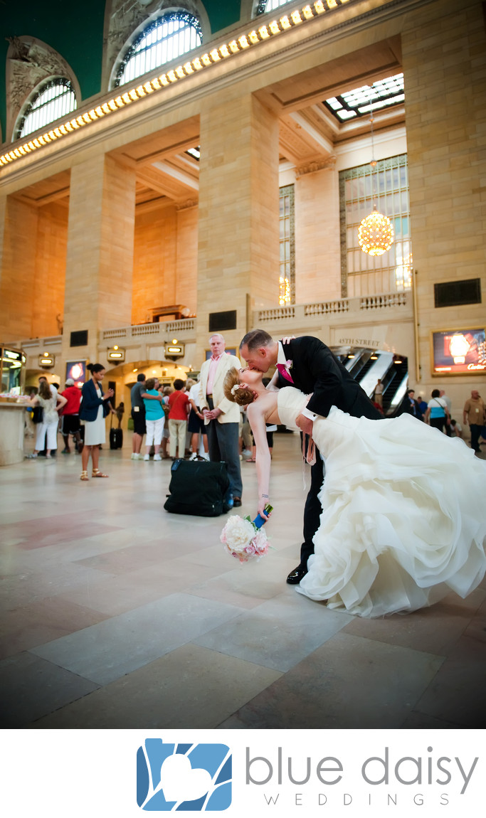 Bride and groom kissing in Grand Central Terminal NYC