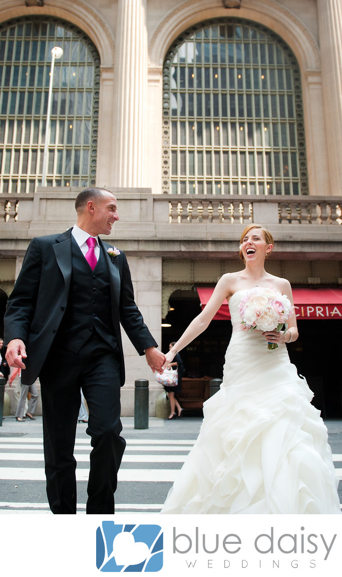 Wedding couple walking in front of Ciprianis NYC