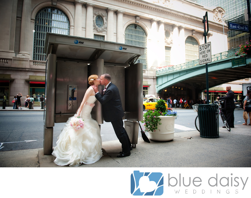 Wedding couple kissing front of Grand Central Terminal