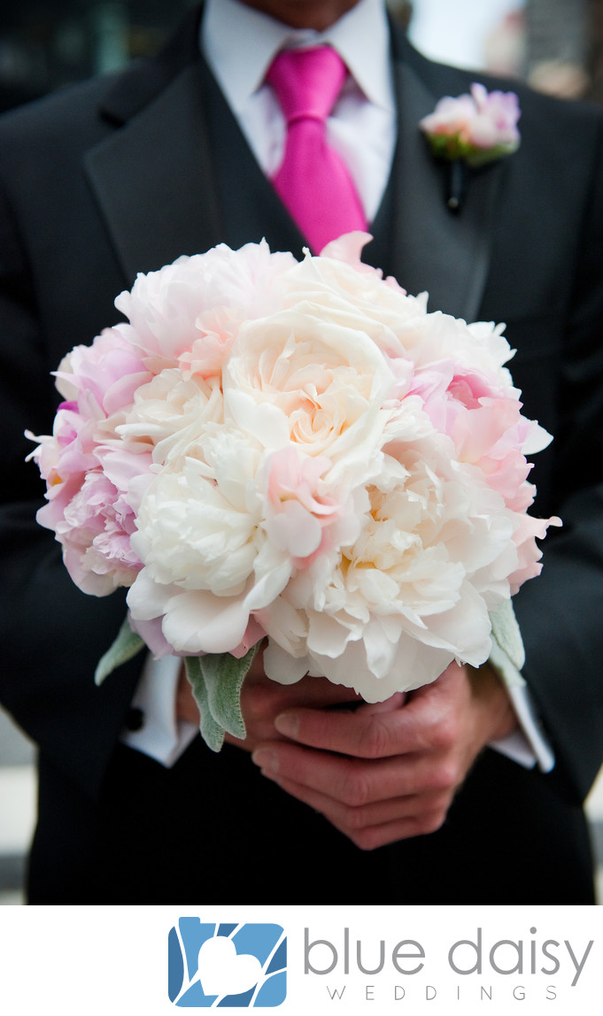 Groom holding white pink peony bridal flower bouquet
