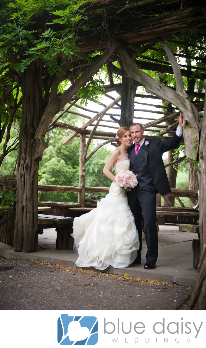 Bride groom in Central Park wooden gazebo