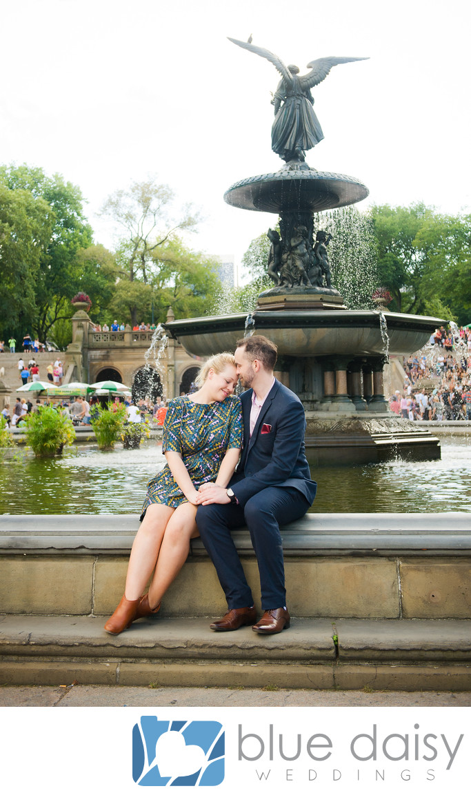 Couple sitting on Bethesda fountain under the angel