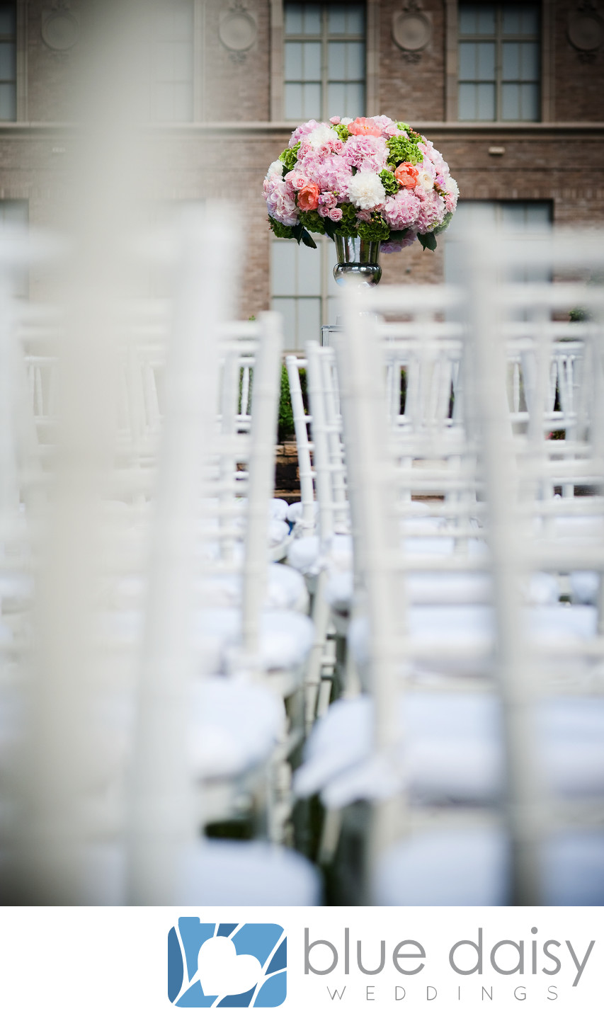 White chairs for NYC rooftop garden wedding ceremony