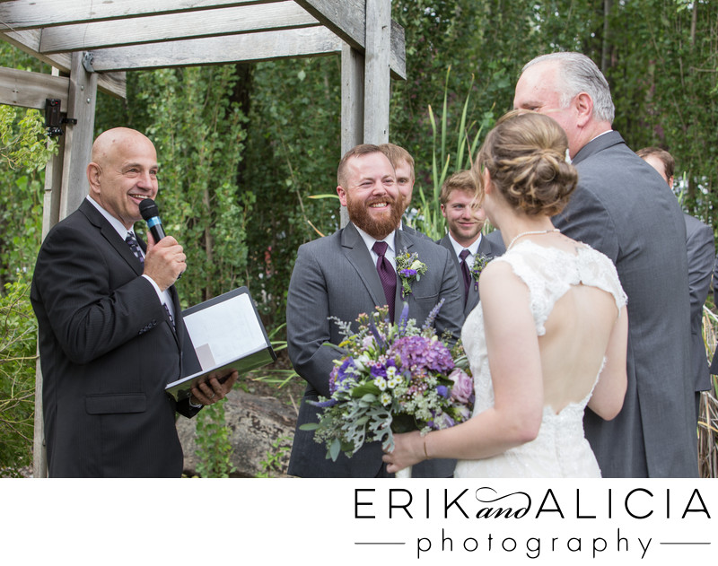 smiling efficient and dad gives away bride