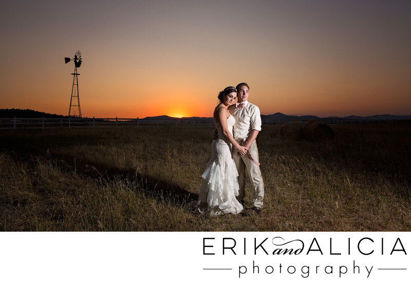 glowing orange sunset bridal portrait with windmill