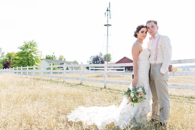 beautiful couple portrait in field with windmill
