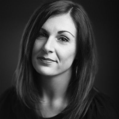 Black and White portrait of photographer Erin Costa