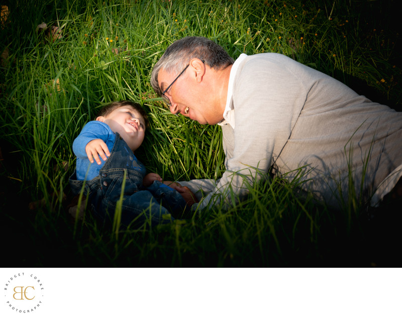 Playful Grandfather and Grandson Romping in Summer Park Shoot Johannesburg by Bridget Corke