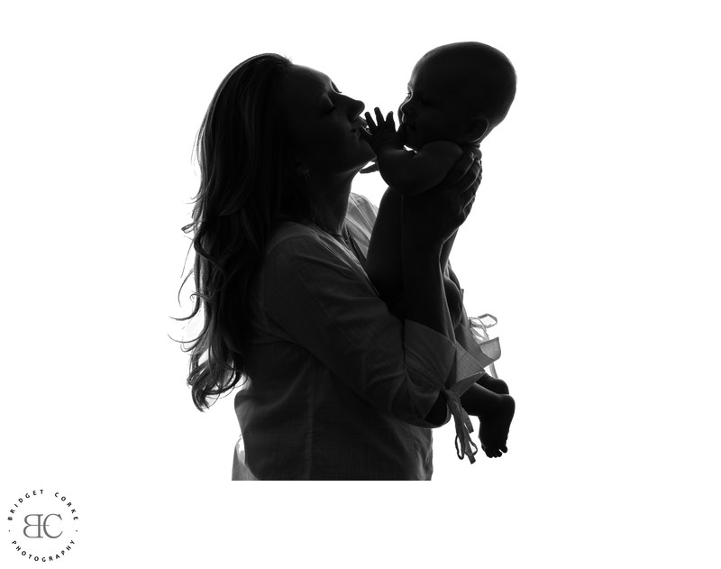Silhouette Of Mother and Child by Bridget Corke