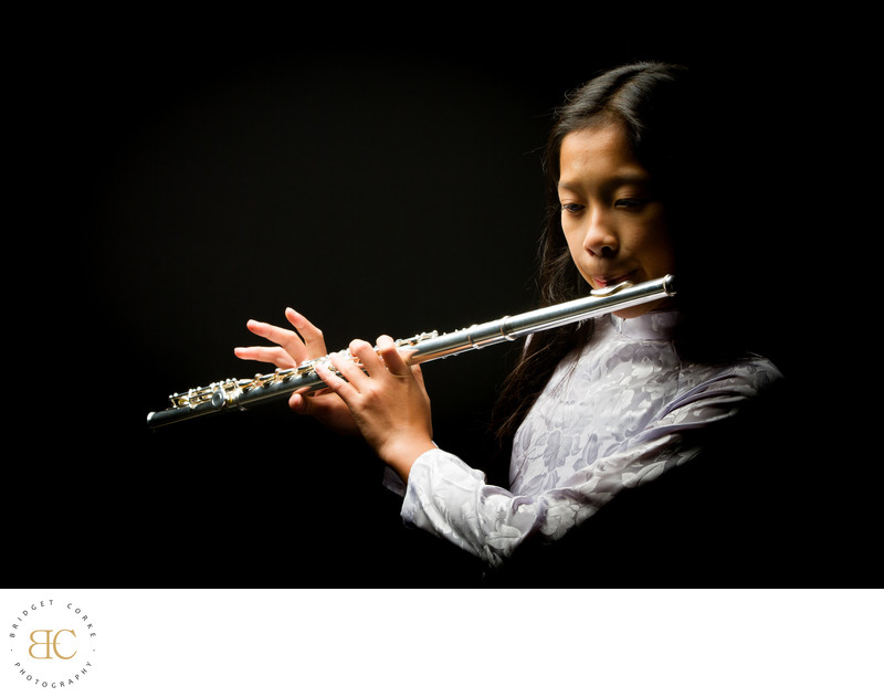 Teenager Playing the Flute During Studio Shoot