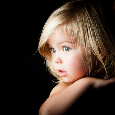 Beautiful Child Peering Over Father's Shoulder During Studio Shoot