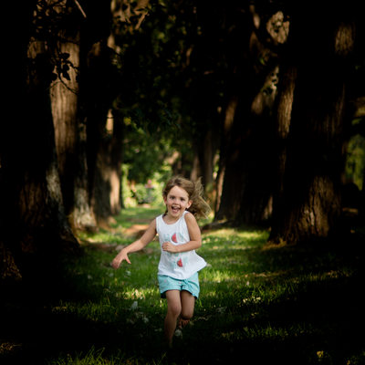 Young Child Racing Through and Avenue of Trees Captured by Johannesburg Photographer