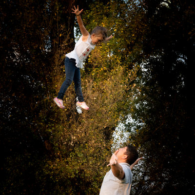 Father Throwing Daughter Playfully into the Air Captured by Family Photographer in Johannesburg