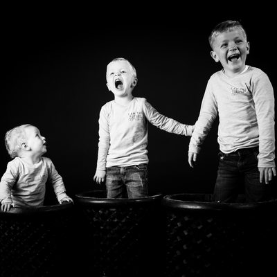 Lively Boys Captured Popping Out of Barrels In Bridget Corke Photographic Studio