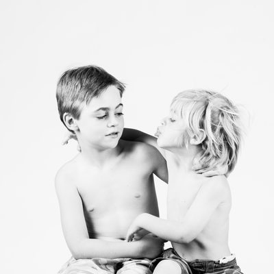 Siblings Photographed on White Background in Studio